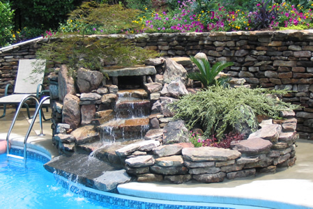 Pool side stone fountain and planter